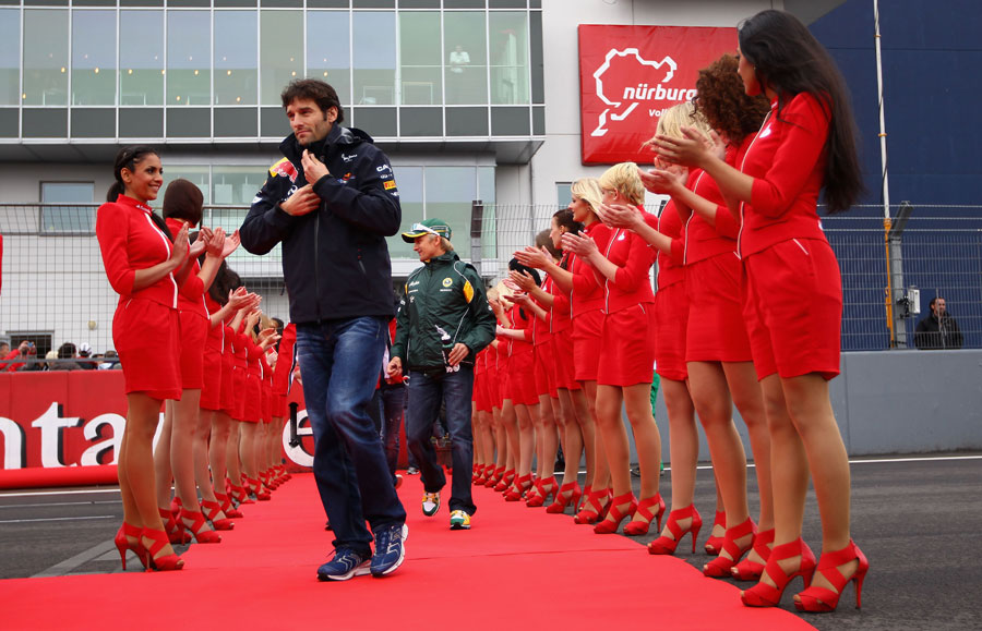 Mark Webber covers up against the cold ahead of the driver's parade