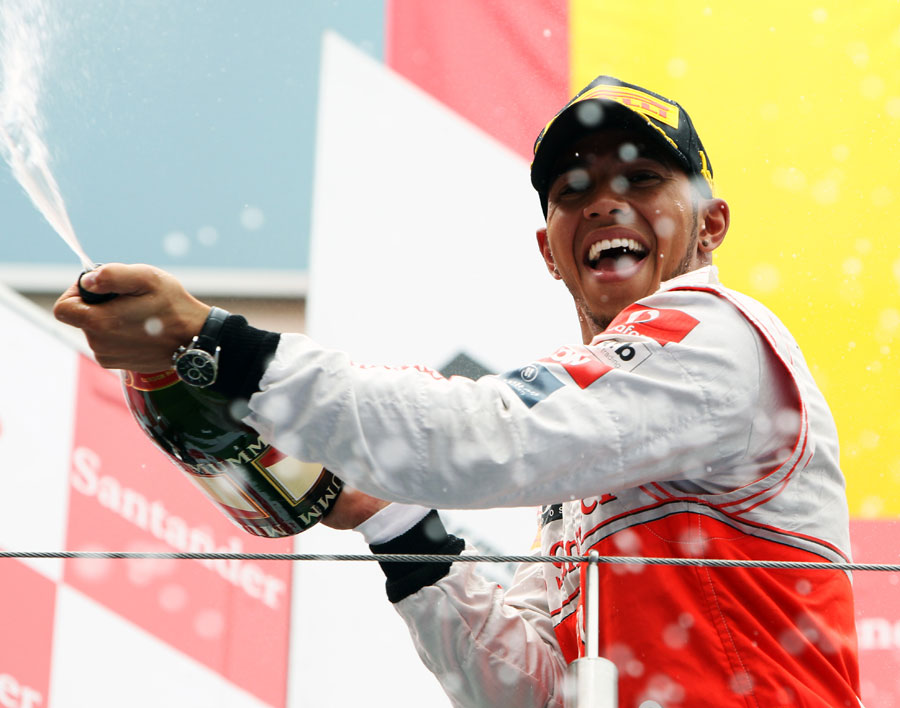Lewis Hamilton celebrates his win on the podium