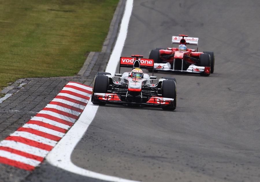 Lewis Hamilton heads Fernando Alonso