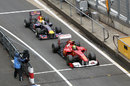 Felipe Massa leads Sebastian Vettel in for the final pit stops on the last lap