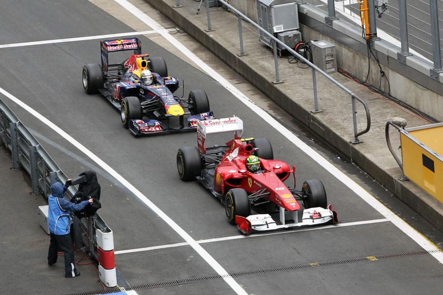 Felipe Massa leads Sebastian Vettel in for the final pit stops on the last lap