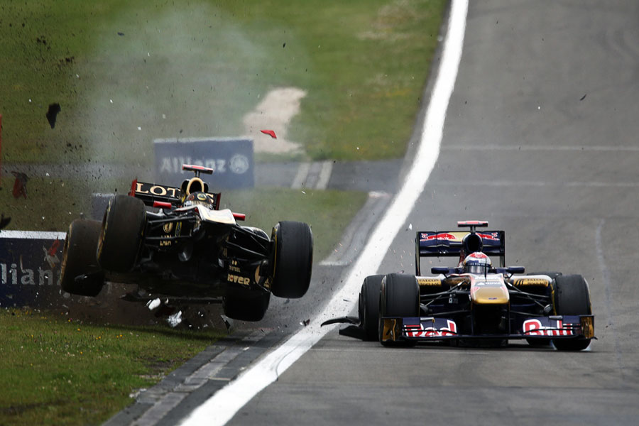 Nick Heidfeld gets airborne after running in to the back of Sebastian Buemi