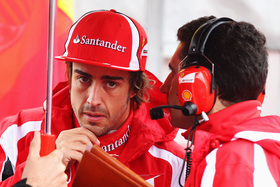 Fernando Alonso talks to his race engineer Andrea Stella before the race