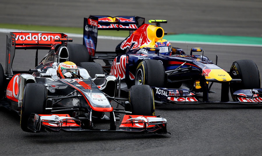 Lewis Hamilton keeps Mark Webber at bay in turn one