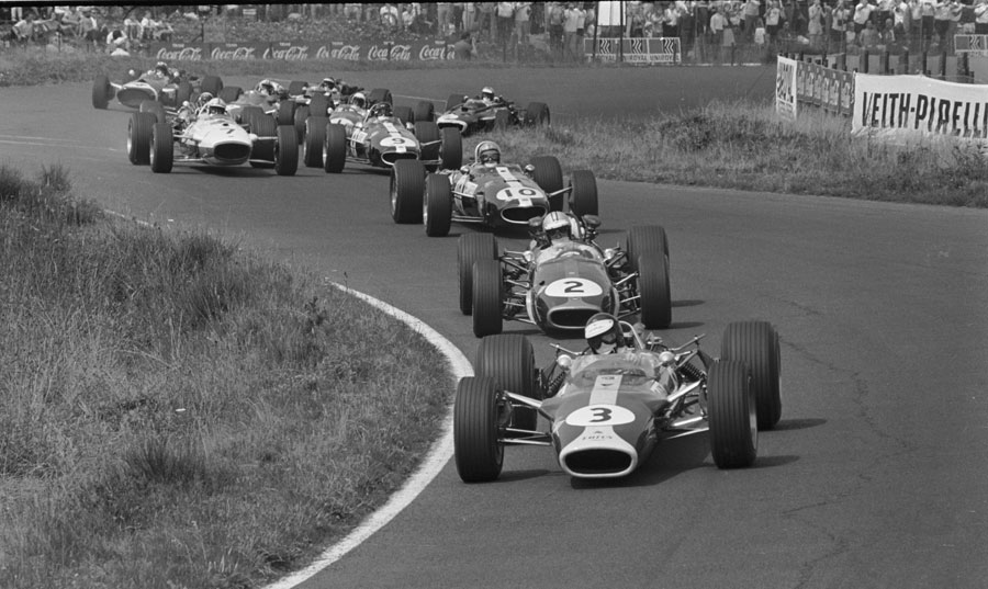Jim Clark leads Brabham's Denny Hulme at the start of the race