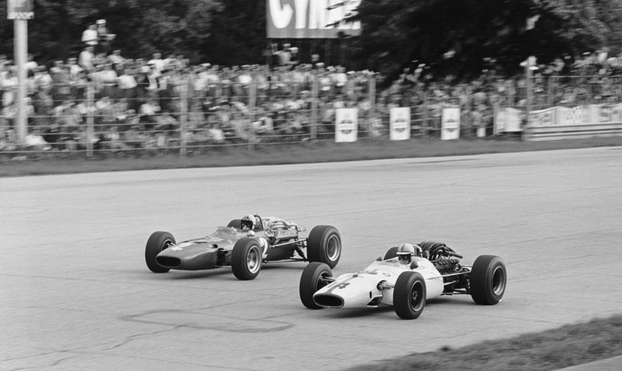 John Surtees and Chris Amon go wheel to wheel down the long straights