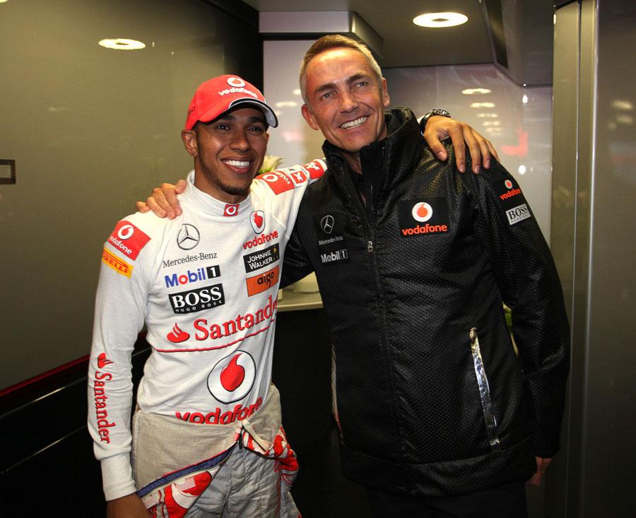 Lewis Hamilton celebrates his victory with Martin Whitmarsh