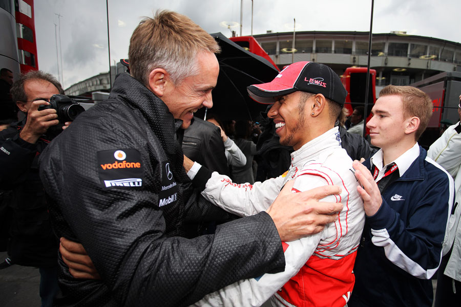 Lewis Hamilton celebrates his victory with Martin Whitmarsh