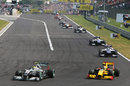 Nico Rosberg holds off Robert Kubica in to turn one