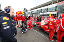 Adrian Newey inspects the back of the Ferrari on the grid