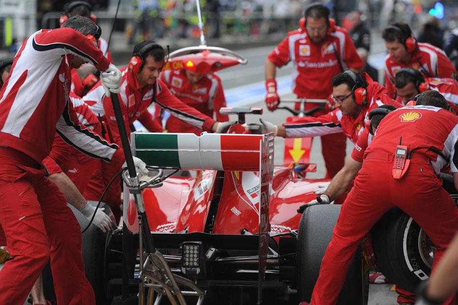Ferrari mechanics practise a pit stop