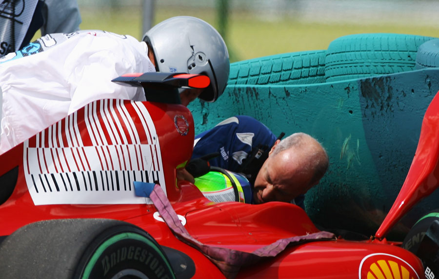 Felipe Massa is attended to after his qualifying accident in Hungary