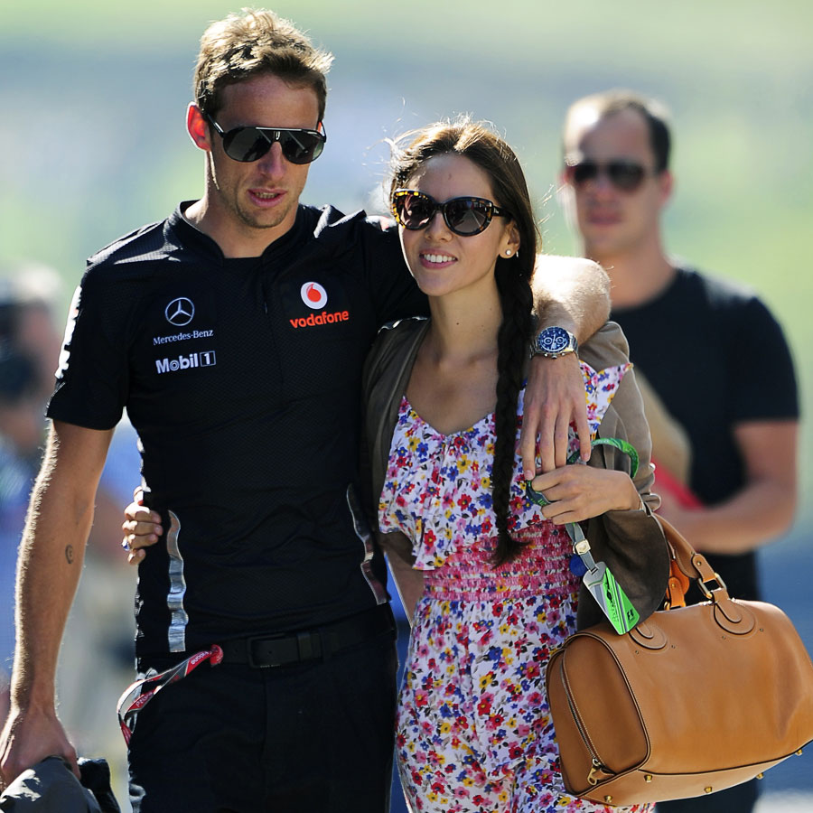 Jenson Button and girlfriend Jessica Michibata arrive on Saturday morning