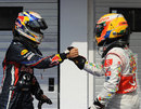 Lewis Hamilton congratulates Sebastian Vettel on taking pole position