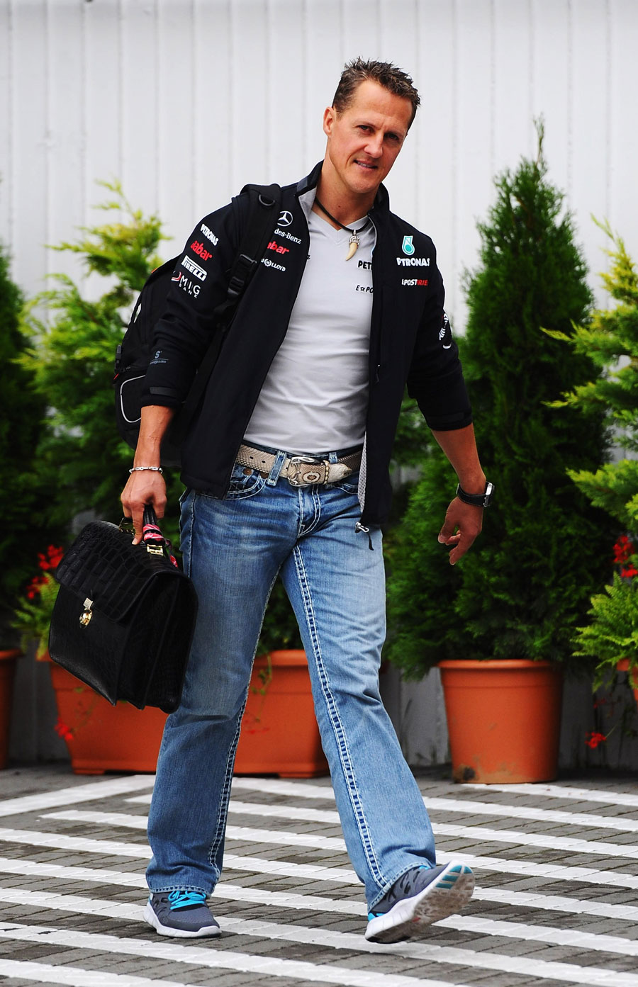 Michael Schumacher arrives in the paddock
