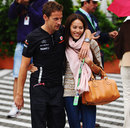 Jenson Button and girlfriend Jessica Michibata arrive in the paddock on Sunday morning