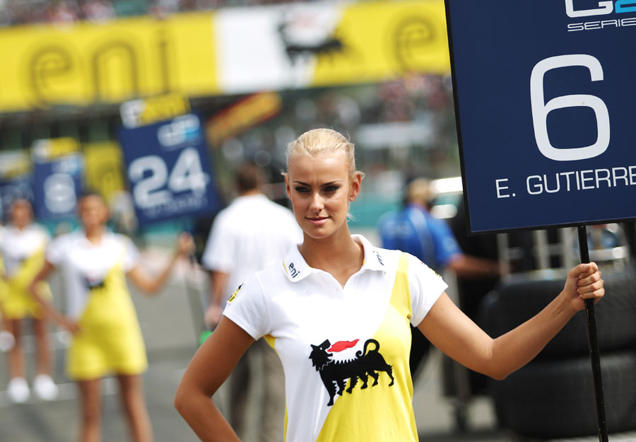 Grid girls line up for the GP2 feature race