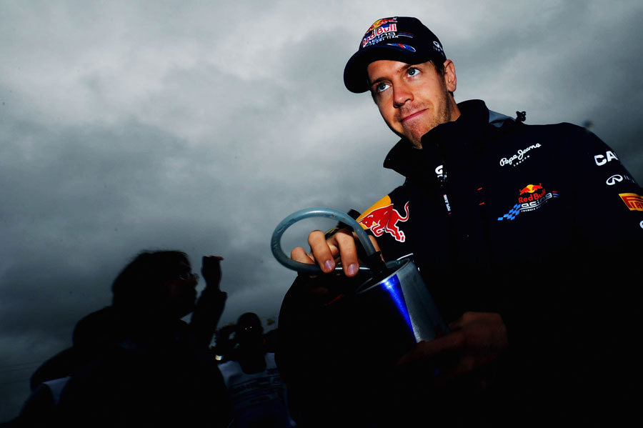 Sebastian Vettel keeps an eye on the skies