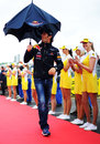 Mark Webber experiences an umbrella failure on his way to the drivers' parade