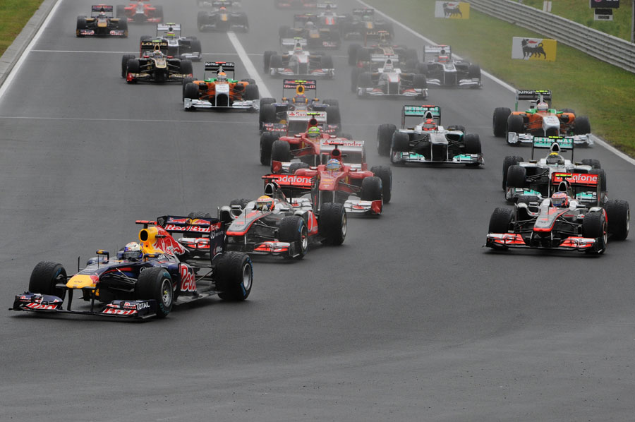 Sebastian Vettel leads the field into the first corner