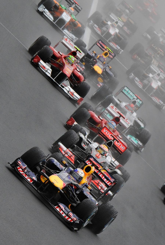 Sebastian Vettel leads the pack on the first lap