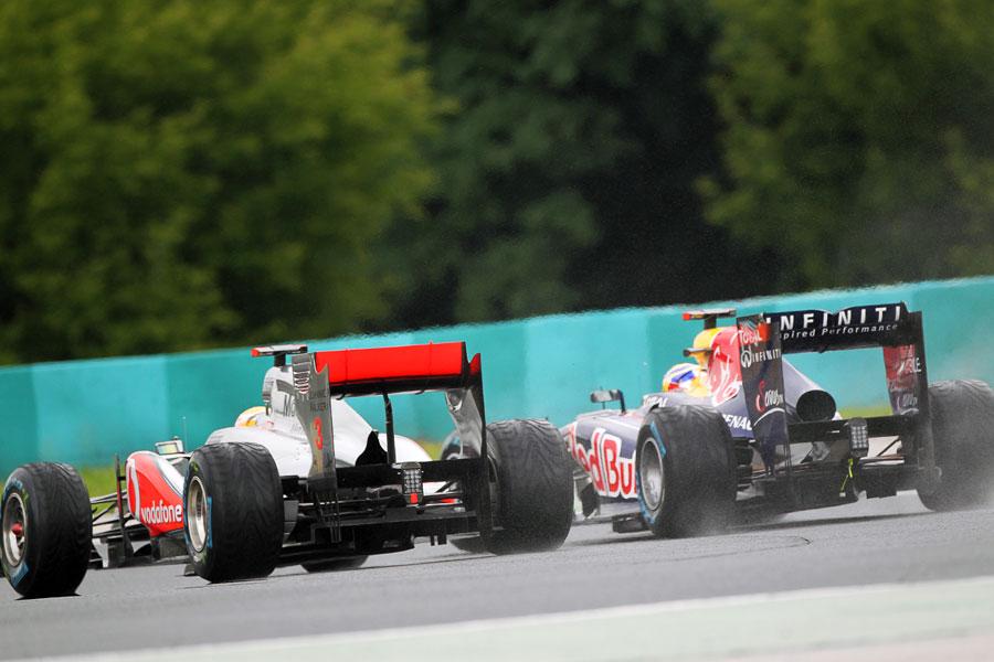 Lewis Hamilton storms up the inside of Sebastian Vettel for the lead