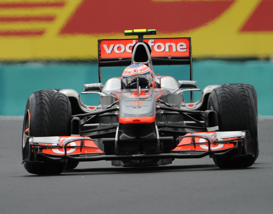 Jenson Button holds a huge slide in the McLaren