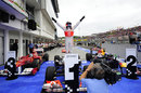 Jenson Button celebrates victory in parc ferme