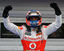 Jenson Button celebrates at the end of his race