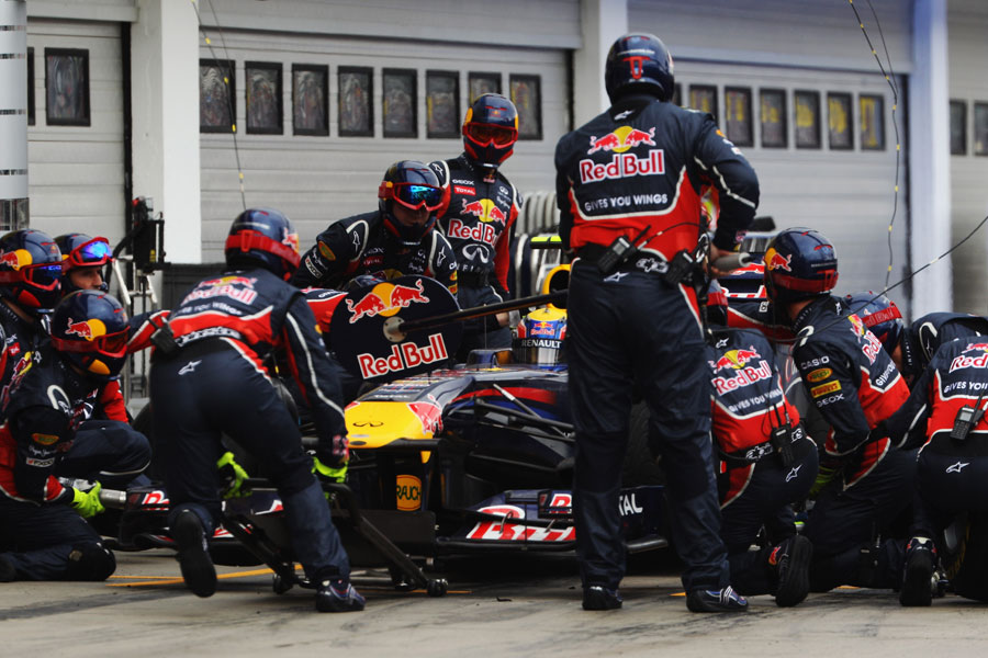 Mark Webber makes a pit stop for intermediate tyres