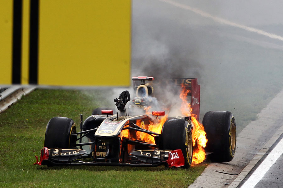 Nick Heidfeld tries to make a quick exit from his burning Renault