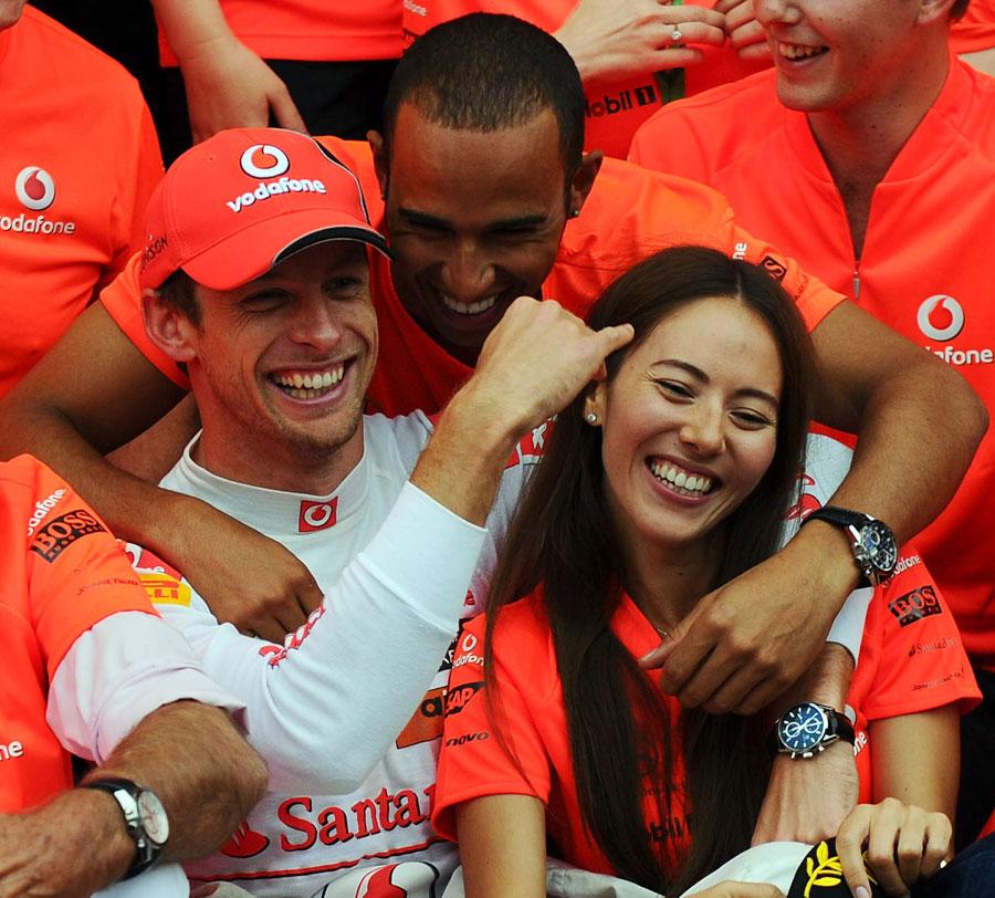 Jenson Button celebrates his victory with his girlfriend Jessica Michibata and Lewis Hamilton