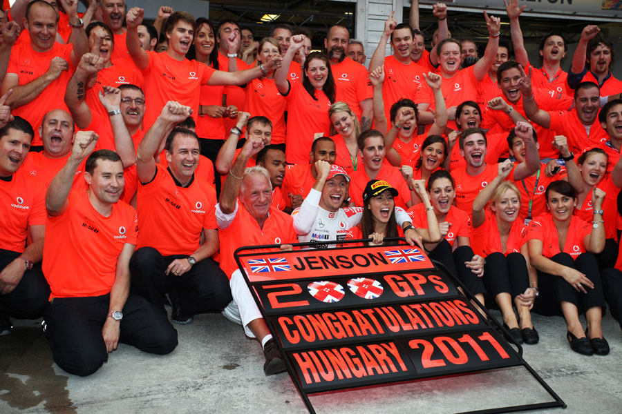 The McLaren team celebrate Jenson Button's victory