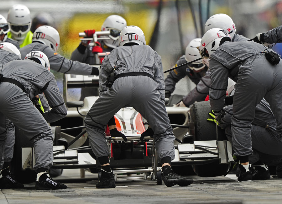 Tonio Liuzzi makes a pit stop