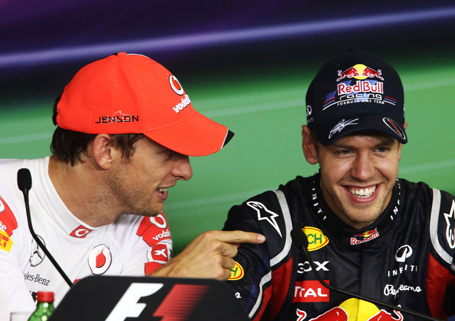 Jenson Button jokes with Sebastian Vettel in the drivers press conference