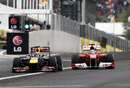 Mark Webber and Fernando Alonso fight for position heading towards the first corner