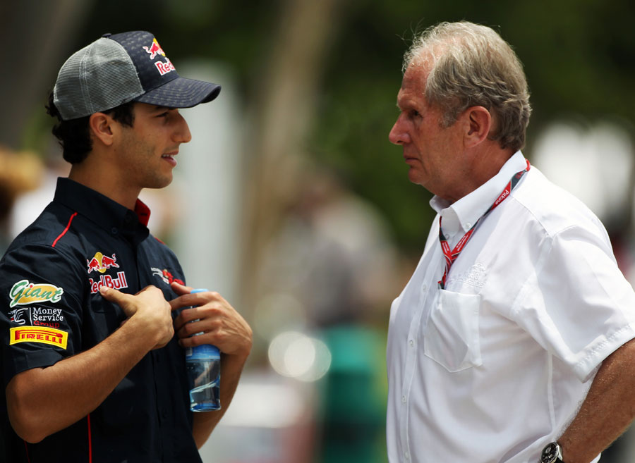 Daniel Ricciardo talks to Helmut Marko in the paddock