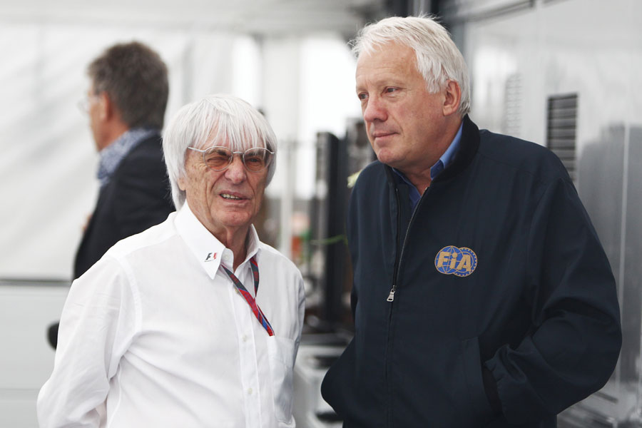 Bernie Ecclestone talks to FIA delegate Charlie Whiting in the paddock on Sunday morning
