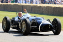 Sir Stirling Moss drives the Ferguson P99 up the hillclimb