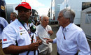 Bernie Ecclestone talks to Tony Fernandes in the paddock