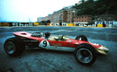 Graham Hill on his way to victory in the new Lotus 49D