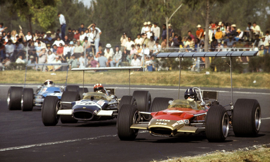 Graham Hill heads Jo Siffert and Jackie Stewart