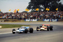 Jochen Rindt hustles Jackie Stewart through Woodcote