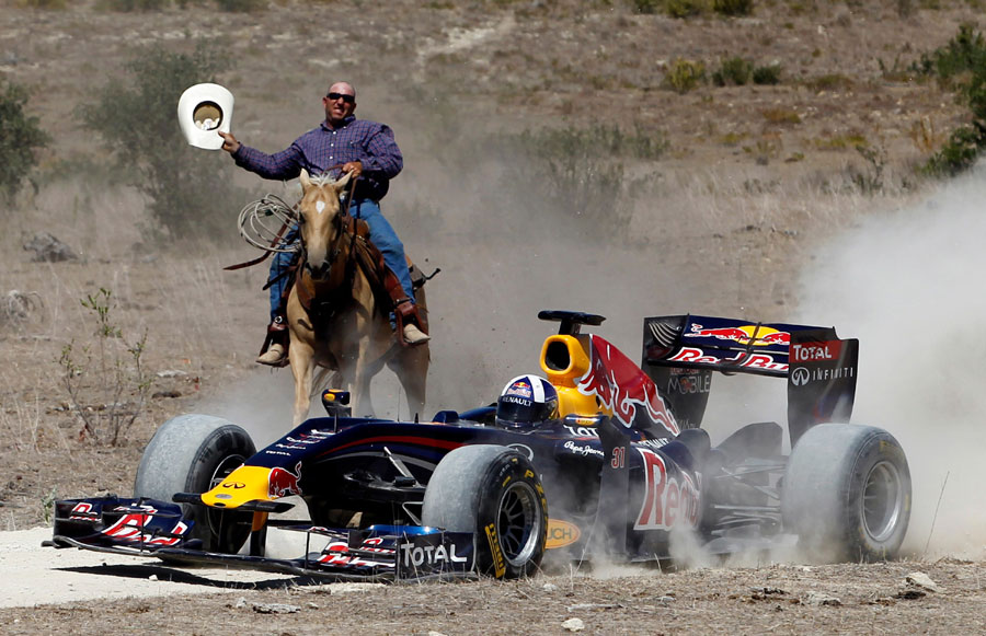 David Coulthard drives the Red Bull show car while being chased by a cowboy at a ranch in Texas