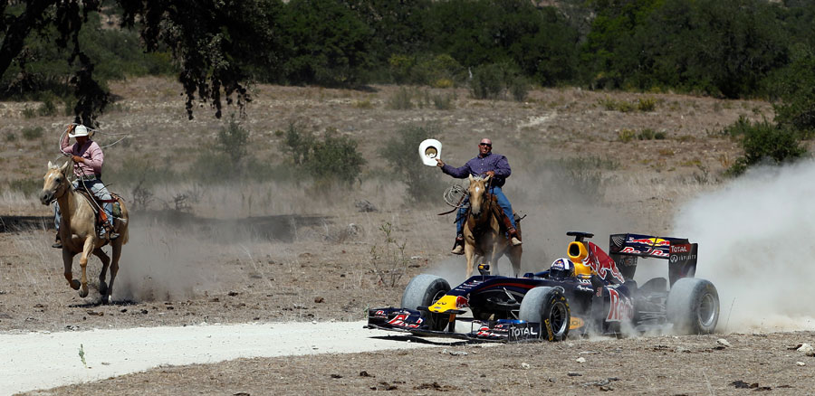 David Coulthard drives the Red Bull show car while being chased by cowboys at a ranch in Texas