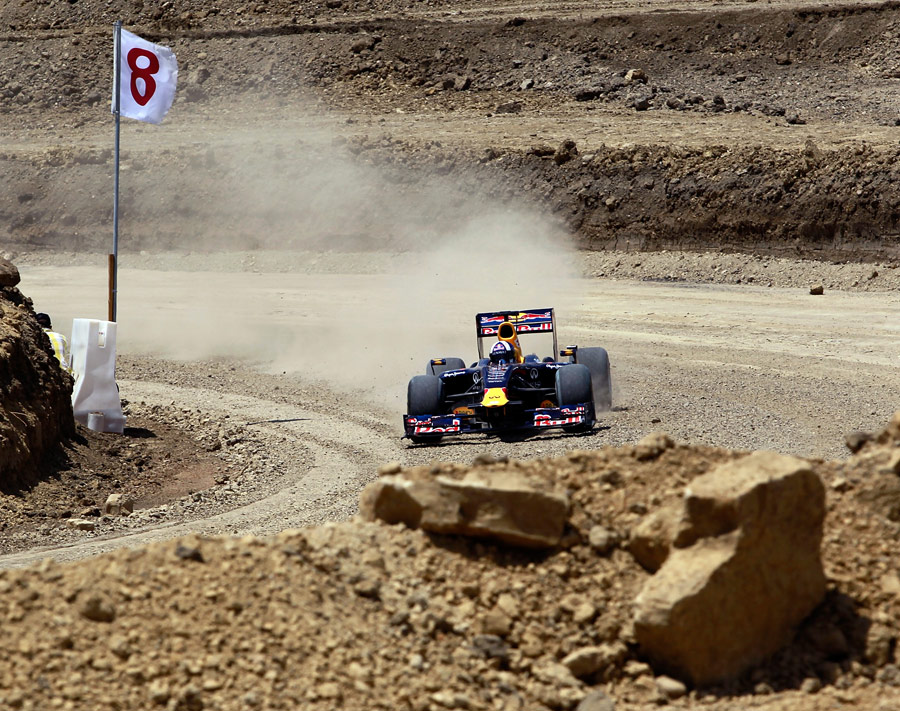 David Coulthard puts the Red Bull show car into what will be turn two at the Circuit of the Americas race track