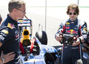 Tom Cruise gets used to the Red Bull steering wheel with David Coulthard