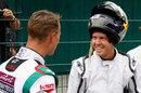 Michael Schumacher and Sebastian Vettel talk after the race