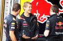 Sebastian Vettel jokes with his Red Bull mechanics