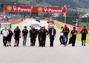 The Renault team walks the track with drivers Bruno Senna and Vitaly Petrov